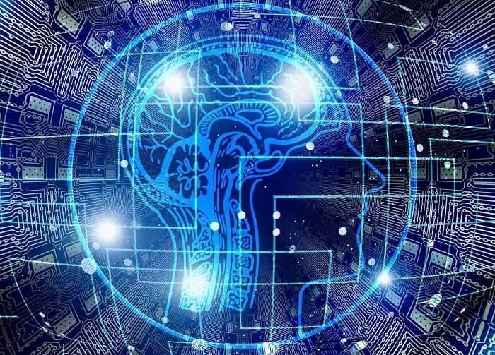 Eine Grafik in blautönen gehalten, die einen Kopf im Profil zeigt und das menschliche Gehirn im Inneren zeigt